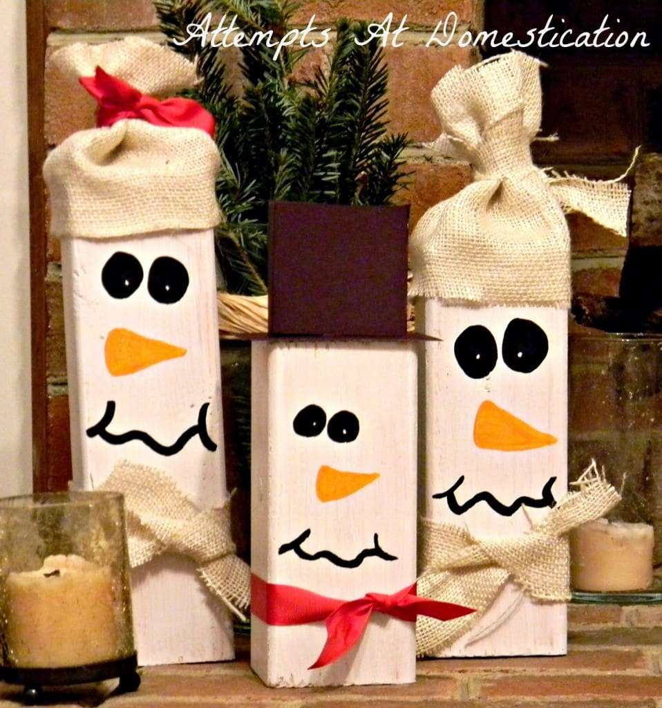these 44 wooden snowmen were quick and easy to whip up and were practically free i love crafting for christmas and its even better when the craft